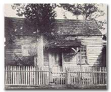 Sam Houston's first home in the new Republic was a shack near the present seat of county government. He later built a home on the west side of Travis between Prairie and Preston, fenced it and painted shrubberies.