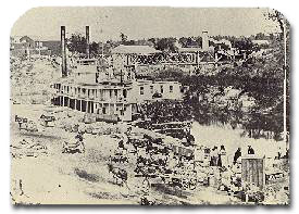 The paddlewheeler St. Claire of Galveston loading cotton at the foot of Main Street, circa 1860s.